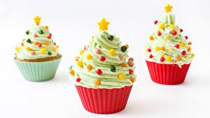 Bilder Neujahr Süßigkeiten Cupcake Weißer hintergrund Design Drei 3 Weihnachtsbaum