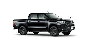 Bilder Toyota Schwarz Metallisch Pick-up Seitlich Weißer hintergrund Hilux X Double Cab, JP-spec, 2020 auto