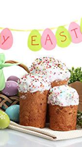 Bilder Feiertage Ostern Kulitsch Weißer hintergrund Ei Englischer das Essen