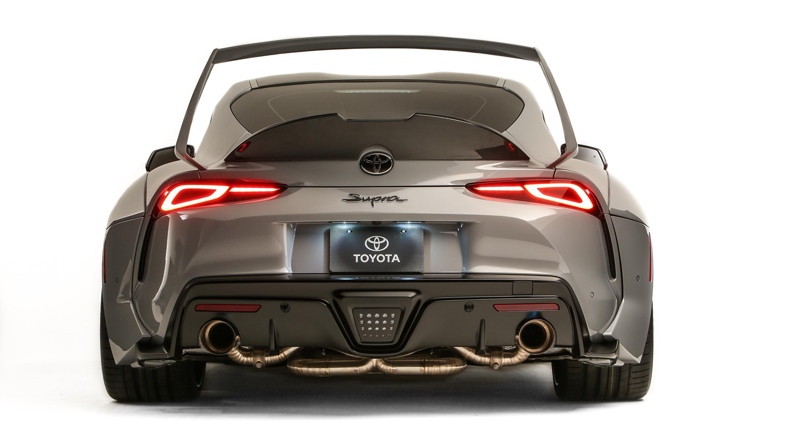 Bilder Toyota GR Supra, A90, 2019, Rutledge Wood, HyperBoost Grau auto Hinten Metallisch Weißer hintergrund 2560x1440 graue graues Autos automobil