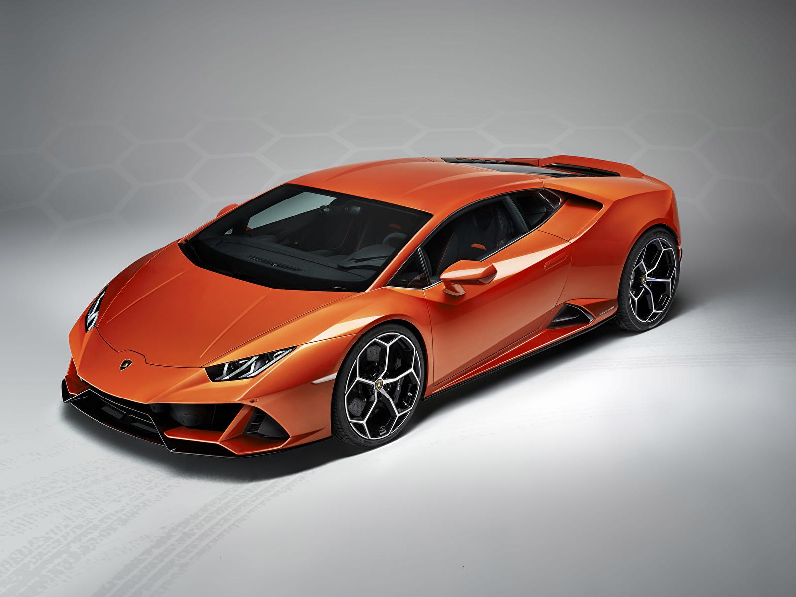 Fotos von Lamborghini 2019 Huracan EVO Orange Autos Grauer Hintergrund 1600x1200