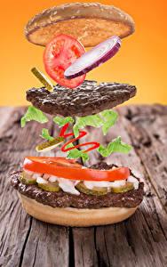 Bilder Fast food Hamburger Fleischwaren Tomate Zwiebel Brötchen