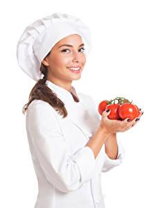 Bilder Tomaten Weißer hintergrund Küchenchef Uniform Lächeln junge frau