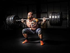 Bilder Mann Bodybuilding Kahlköpfiger Tätowierung Muskeln Hantelstange Barthaar Sport