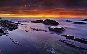 Fotos Landschaftsfotografie Meer Sonnenaufgänge und Sonnenuntergänge Steine Himmel