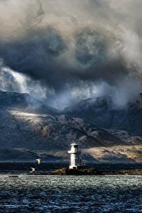 Bilder Schottland Leuchtturm Berg Abend Meer Küste Wolke Argyle Natur