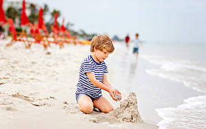 Photo Beaches Sand Boys Sitting child