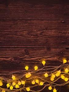 Hintergrundbilder Neujahr Bretter Vorlage Grußkarte Lichterkette