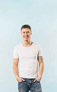 Desktop hintergrundbilder Mann Farbigen hintergrund Lächeln Blick