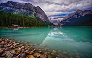 Bilder Kanada See Gebirge Wälder Steine Landschaftsfotografie Lake Louise  Alberta