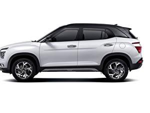Fotos Hyundai Weiß Metallisch Seitlich Crossover Weißer hintergrund Creta, MX-spec, (SU2), 2020 Autos