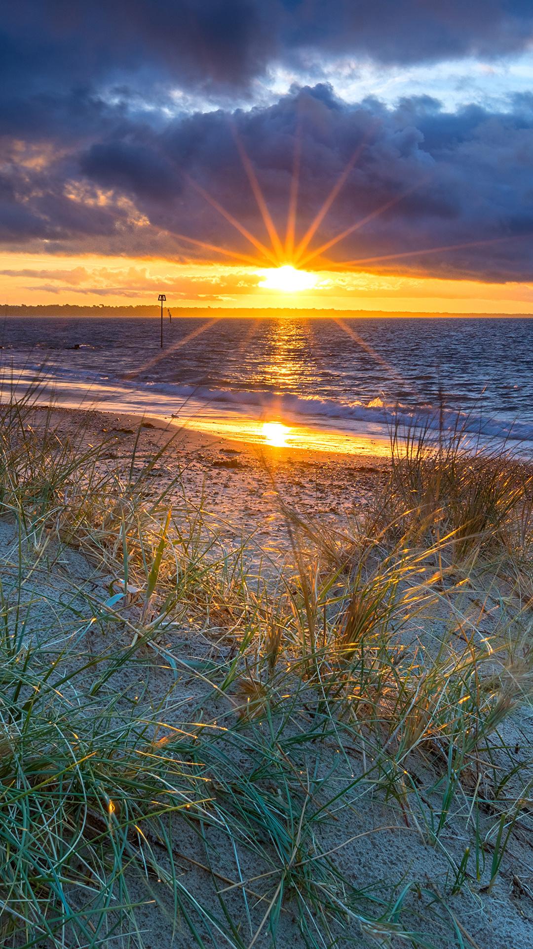 Foto England Bournemouth Sonne Natur Landschaftsfotografie Sonnenaufgänge und Sonnenuntergänge Küste Steine Wolke 1080x1920 für Handy Morgendämmerung und Sonnenuntergang Stein