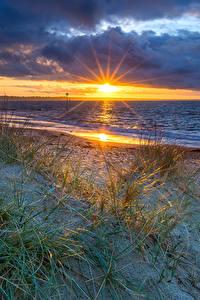 Fotos England Landschaftsfotografie Sonnenaufgänge und Sonnenuntergänge Küste Stein Wolke Sonne Bournemouth Natur