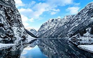 Bilder Norwegen Flusse Felsen Schnee Fjord Natur