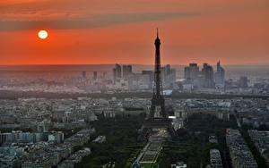 Fotos Sonnenaufgänge und Sonnenuntergänge Frankreich Paris Turm Eiffelturm Sonne Städte