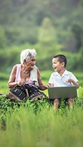 Pictures Asian Grass Boys Laptops Sitting 2 Old woman Children