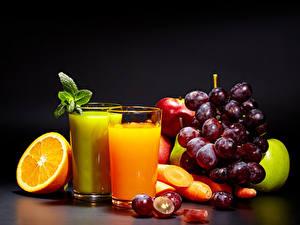 Fotos Saft Orange Frucht Weintraube Obst Trinkglas Schwarzer Hintergrund