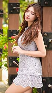 Photo Asian Blurred background Brown haired Dress Hands female