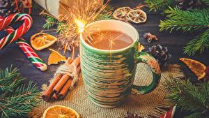 Hintergrundbilder Neujahr Kakao Getränk Zimt Süßware Tasse Wunderkerze Lebensmittel