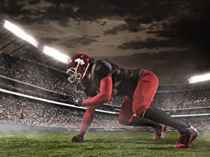 Bilder American Football Mann Uniform Helm Hand Stadion sportliches