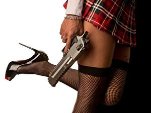 Bilder Pistolen Großansicht Nylonstrumpf Bein Rock High Heels Weißer hintergrund