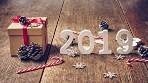 Bilder Neujahr Dauerlutscher Bretter Schneeflocken 2019 Zapfen Geschenke