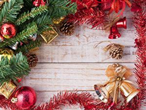 Bilder Neujahr Bretter Ast Kugeln Zapfen Glocke