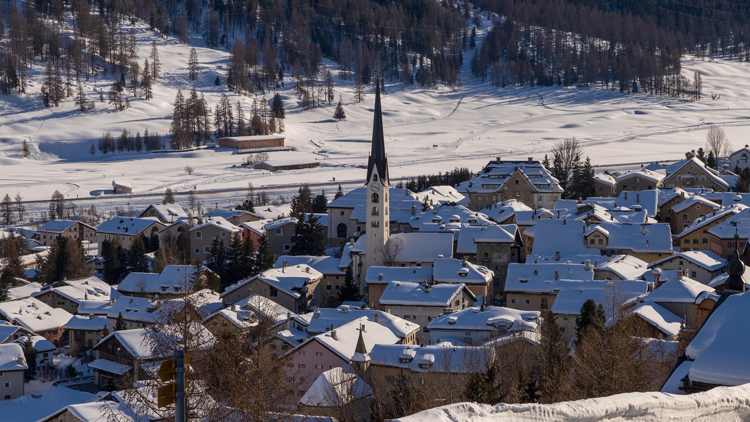 Foto La chiesa Svizzera Il villaggio Inverno Neve Città La casa 2560x1440 insediamento umano edificio