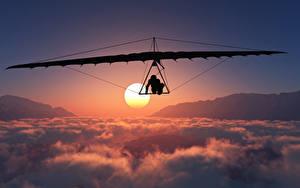Fotos Flug Wolke Sonne Hang gliding Sport