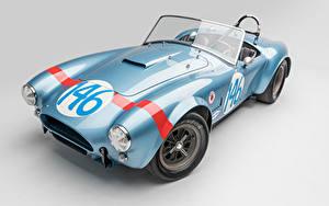 Bilder Shelby Super Cars Antik Grauer Hintergrund Hellblau Cabrio Roadster 1964 Shelby Cobra 289 FIA Competition Autos