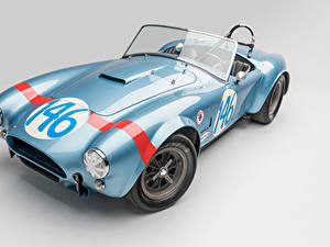 Bilder Shelby Super Cars Antik Grauer Hintergrund Hellblau Cabrio Roadster 1964 Shelby Cobra 289 FIA Competition Autos