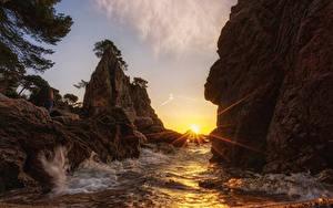 Hintergrundbilder Küste Sonnenaufgänge und Sonnenuntergänge Wasserwelle Felsen Lichtstrahl Sonne