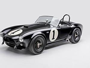 Bilder Shelby Super Cars Retro Grauer Hintergrund Schwarz Metallisch Cabriolet 1962 Shelby Cobra 289 Autos