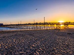 Bilder USA Sonnenaufgänge und Sonnenuntergänge Küste Brücke Strände Newport Beach Natur