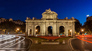 Picture Madrid Spain Sculptures Roads Town square Night time Arch Puerta de Alcala Cities