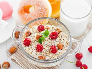 Bilder Müsli Himbeeren Schalenobst Frühstück Lebensmittel