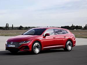 Fotos Volkswagen Rot Metallisch Fährt Kombi Arteon, R-Line, Shooting Brake