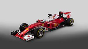Bilder Ferrari Formula 1 Grauer Hintergrund Rot 2016  SF16-H  Formula Cars Autos Sport