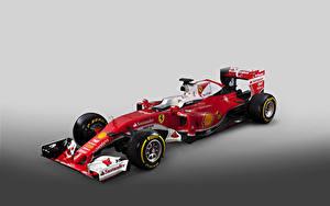 Bilder Ferrari Formula 1 Grauer Hintergrund Rot 2016  SF16-H  Formula Cars auto Sport