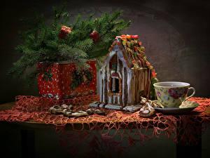 Bilder Neujahr Stillleben Backware Haus Kekse Ast Tasse Lebensmittel