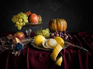 Bilder Stillleben Weintraube Äpfel Zitrone Kürbisse Granatapfel Messer Grauer Hintergrund Lebensmittel