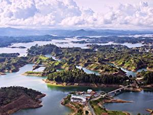 Fotos Kolumbien Landschaftsfotografie Flusse Küste Haus Wolke Hügel Von oben Natur