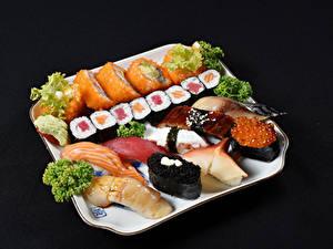 Fotos Meeresfrüchte Sushi Fische - Lebensmittel Schwarzer Hintergrund Lebensmittel