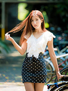 Pictures Asian Bokeh Skirt Blouse Hands Hair Brown haired Girls