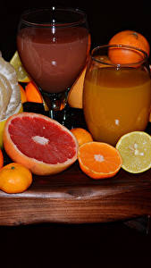 Hintergrundbilder Zitrusfrüchte Orange Frucht Zitrone Saft Mandarine Grapefruit Schwarzer Hintergrund Trinkglas Lebensmittel