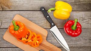 Fotos Peperone Messer Bretter Schneidebrett Lebensmittel