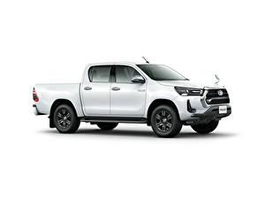 Fotos Toyota Pick-up Weiß Metallisch Seitlich Weißer hintergrund Hilux Z Double Cab, JP-spec, 2020 Autos
