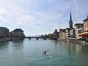 Bilder Zürich Schweiz Flusse Brücken Boot Gebäude Limmat River, Canton of Zurich Städte