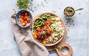 Bilder Reis Fleischwaren Gemüse Tomate Schneidebrett Teller Schüssel Lebensmittel