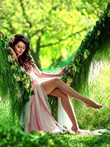 Image Brown haired Gown Sit Swing Legs Beautiful young woman